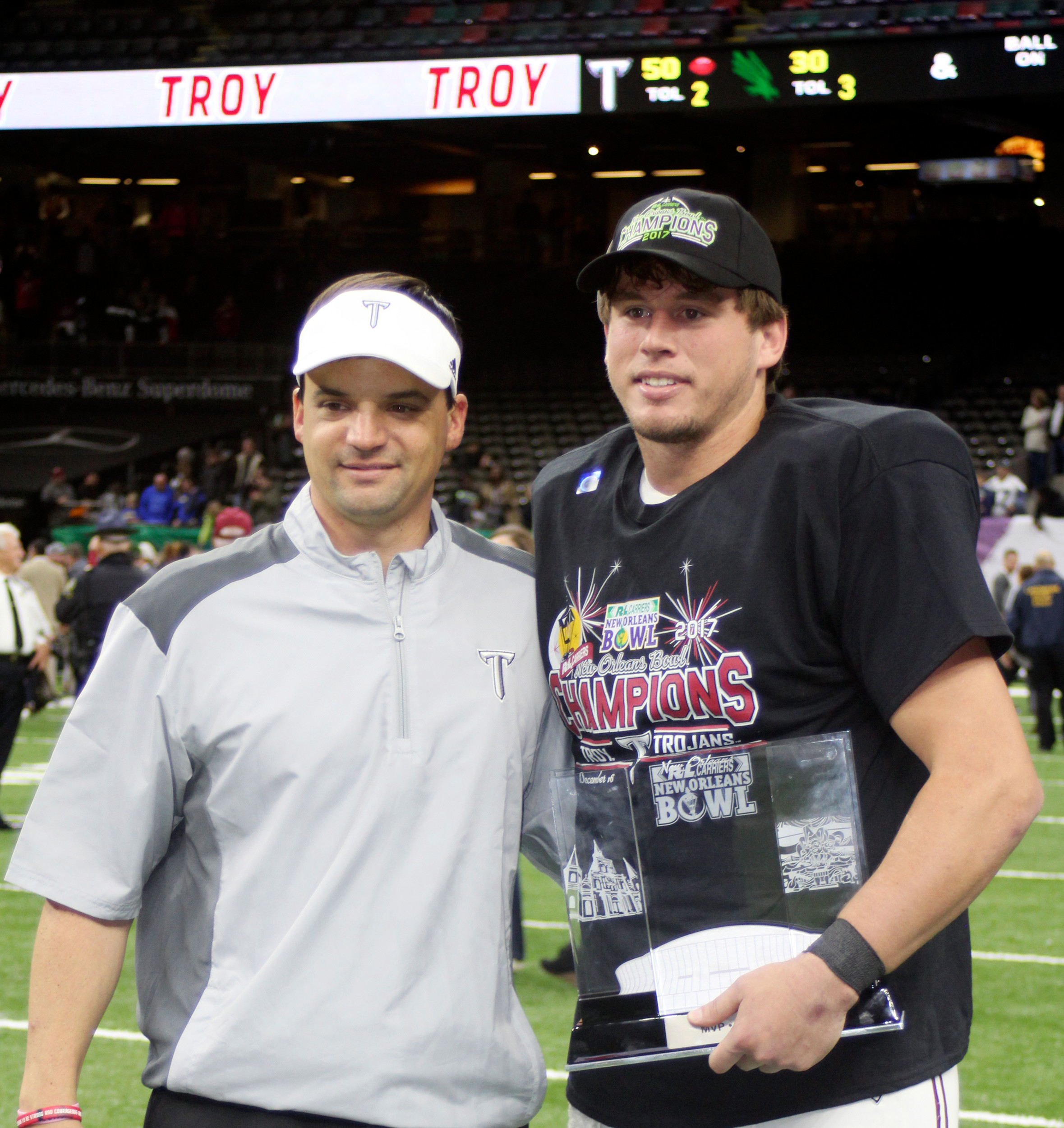 Trojans head coach Neal Brown (left) with Brandon Silvers.