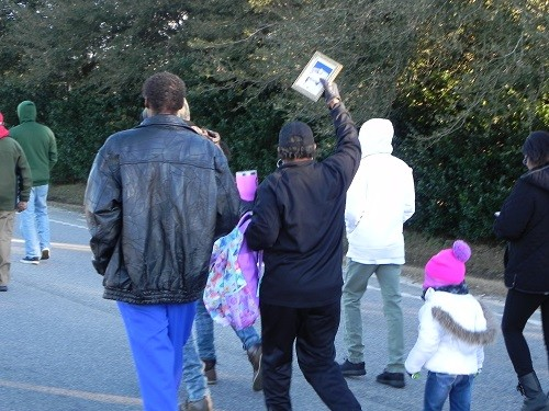 Residents march up Alabama 59 during last year's Dr. Martin Luther King Jr. Day of Remembrance.