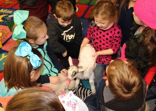 Pictured feeding Cupid and Prancer are kindergarten students Ana Leah Hayes, Trenton Hadley, Ana Reese Bryant, Jaley Brinkman, Ethan Harville and Vivyenne Duff.