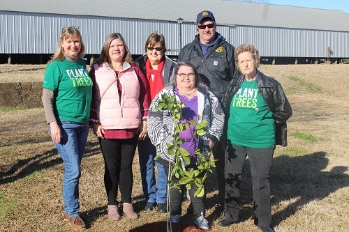 Terry Simpson, landscaping supervisor with the Robertsdale Public Works Department, joins Park, Street and Tree Committee members, from left, Ruthie Campbell, Cindy Adams, Sue Cooper, Sonja Connor and Nell Calloway in planting an L.A. Sweet Orange tree at the George P. Thames Adult Activity Center in preparation for the city's Arbor Day celebration on Saturday, Feb. 24 in Honeybee Park. Not pictured are committee members Amanda Brill, Jodee Darby and June Kennedy. This year, the Park, Street and Tree Committee will be raffling a citrus tree as part of its Arbor Day program, and giving away 1,050 other trees of numerous varieties on a first-come, first-served basis.