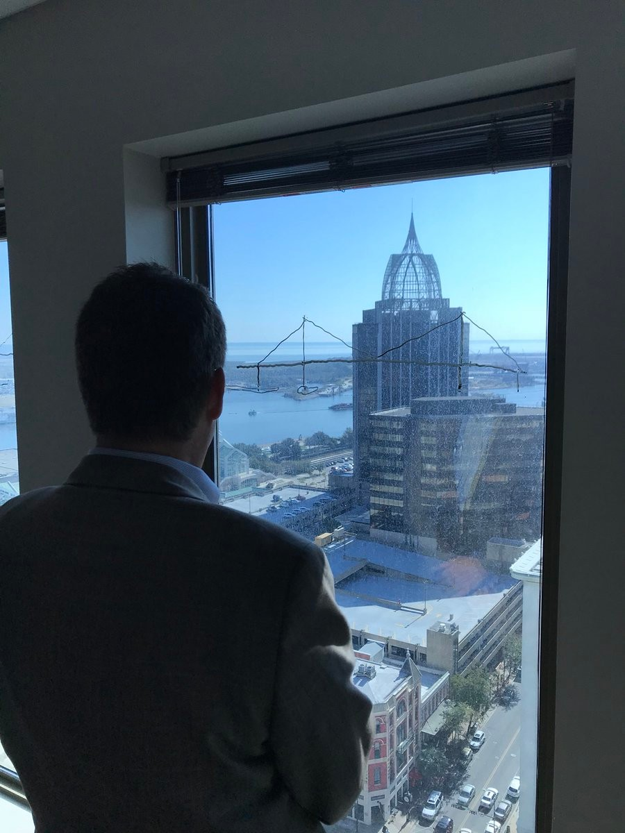 Baldwin County Commissioner Tucker Dorsey views a mockup of the potential new I-10 bridge from the Trustmark Building in Mobile.
