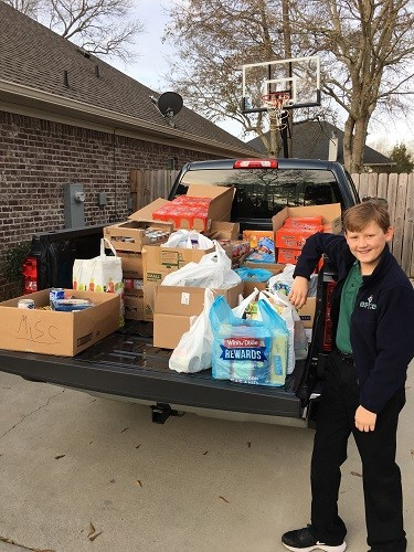 St. Patrick School student Austin Gontarski collected a truck load of supplies and more for the Catholic Social Services back pack program.