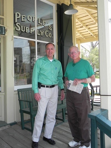 Sidney Chandler and his son Bryan pose in front of United Bank for an article in 2016. Bryan Chandler is a loan officer and occupies an office upstairs where Sidney Chandler and his family lived when they owned People's Supply Co., which is now occupied by the Bank.