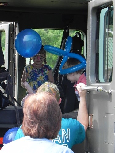 Local children take a tour of a Loxley Fire Department truck during the town's annual Easter Egg Hunt, sponsored by the Loxley Fire Department Auxiliary.