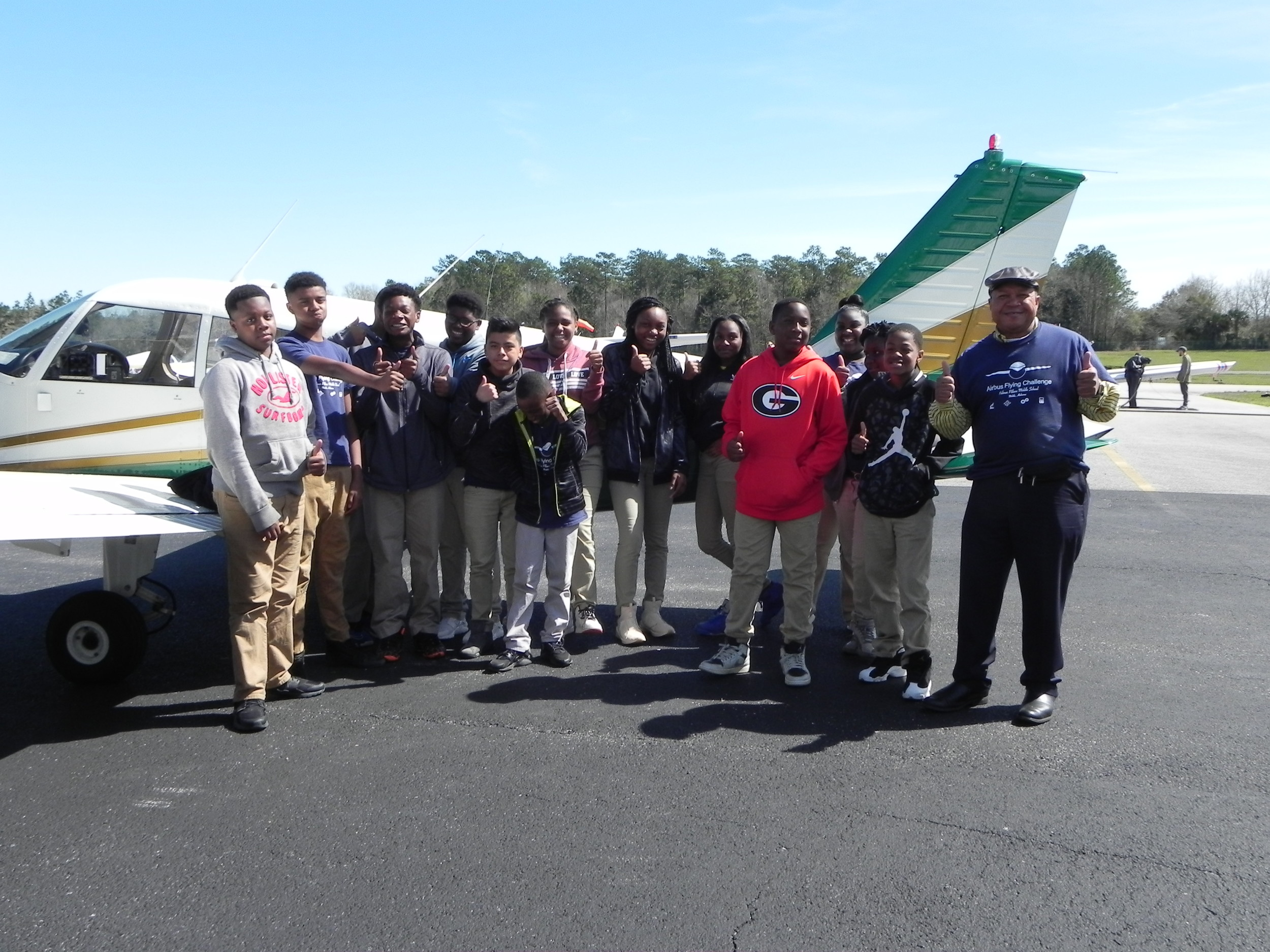 Students and mentors in the Airbus Foundation Flying Challenge prepare to take a ride in an airplane thanks to the pilots at Lightning Aviation.