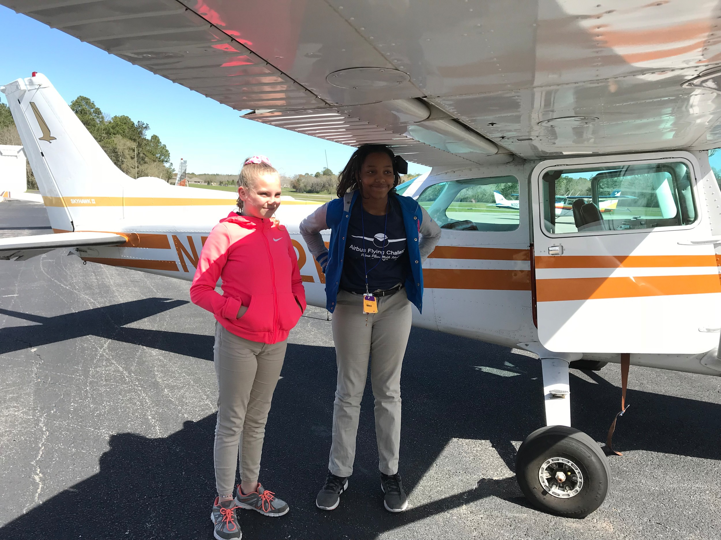 The first two student flyers and their pilot return from a trip above Foley and Gulf Shores.