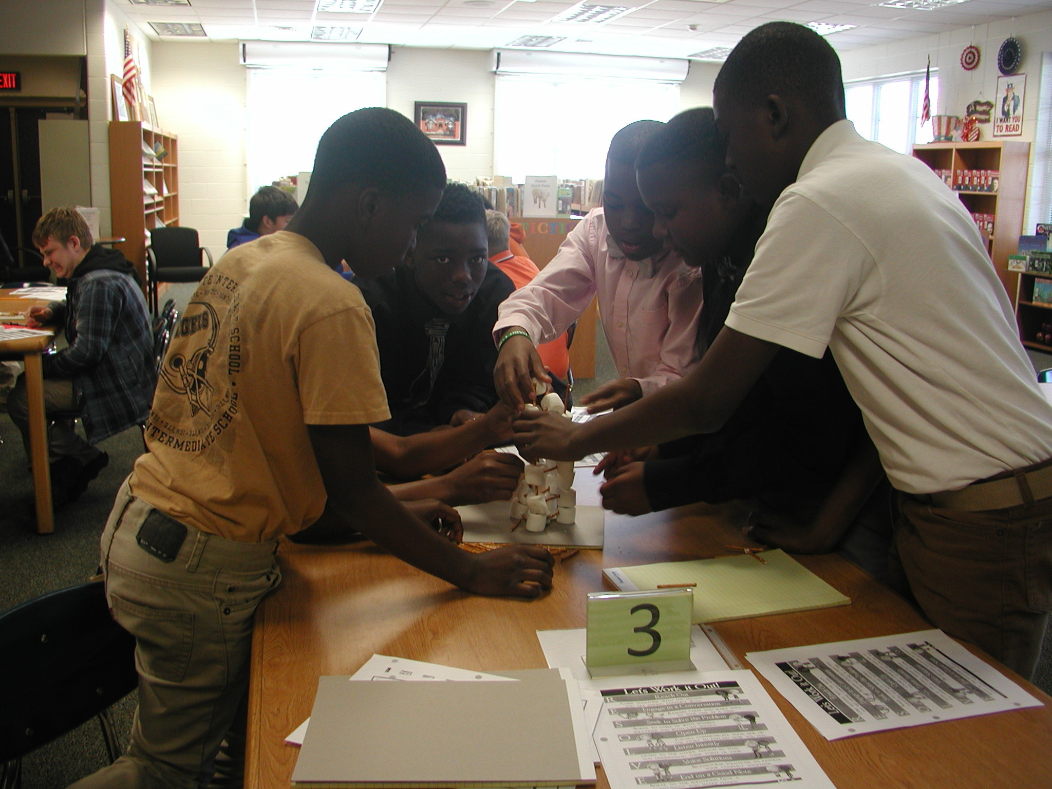 The Guys With Ties club learns about conflict resolution by doing hands-on activities.