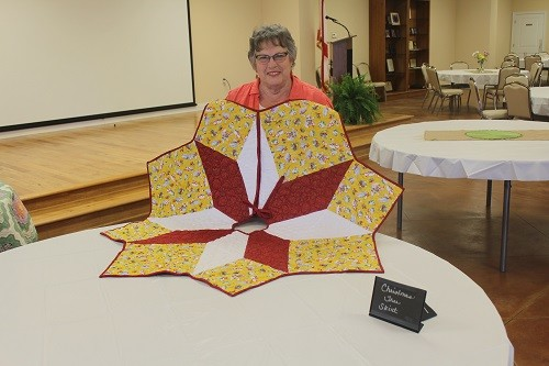 Barbara Krob with her Christmas tree skirt.