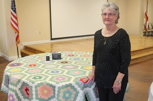 Pam Madden with her hand-stitched cotton quilt.