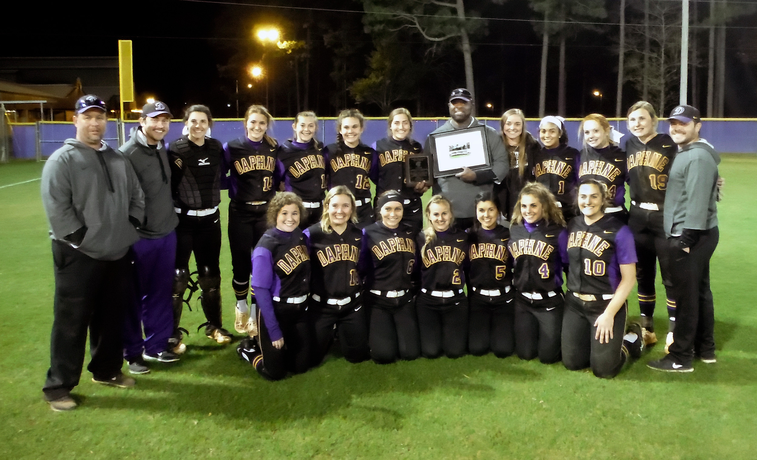"DHS head softball coach Lawrence T. ""Poochie"" Yelding with his 2018 staff and players after win No. 605 at Daphne High, May 8. He reached the 600-win mark a week into his 15th season on Feb. 24 in an away game win over Faith."