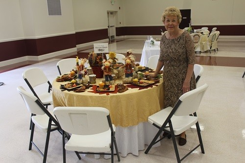 Evelyn Lowery, hostess for the Harvest Queen table.
