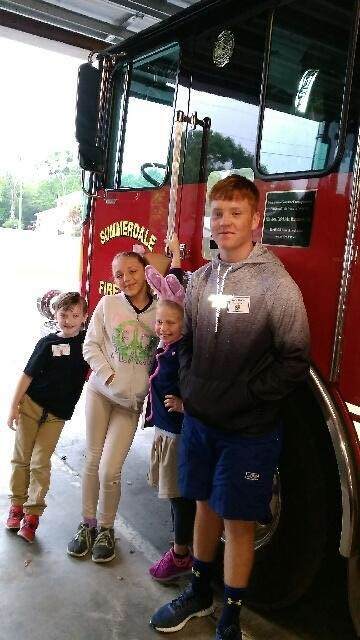 The students took a trip to the town fire station.