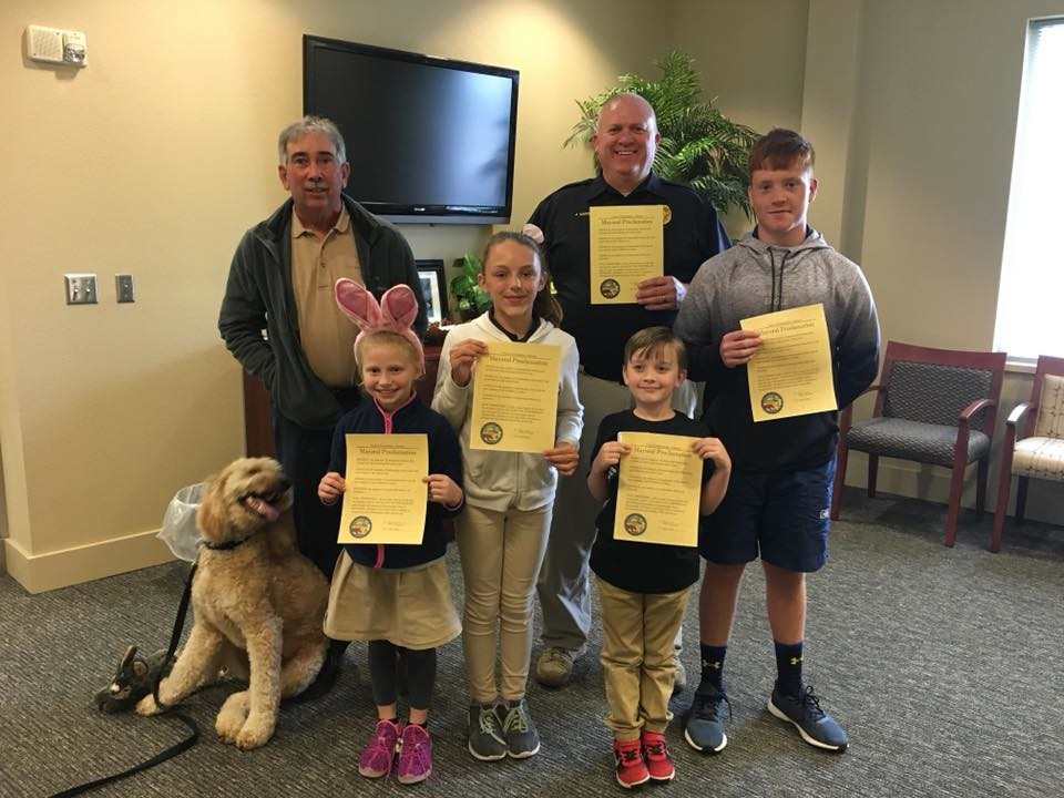 From left to right: Mayor David Wilson; Rylie Jones, Mayor for the Day; Katelyn Forland, Firefighter for the Day; Police Chief Jim Davis; Finely Wren, Police Chief for the Day; and Nate Steiner, Police Chief for the Day.