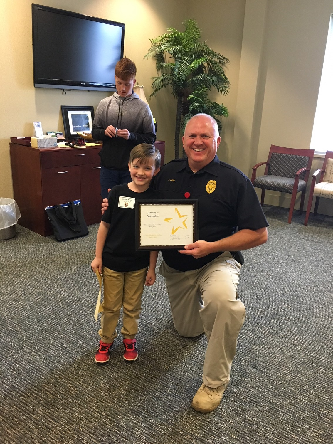 Police Chief for the Day Finely Wren and Police Chief Jim Davis.