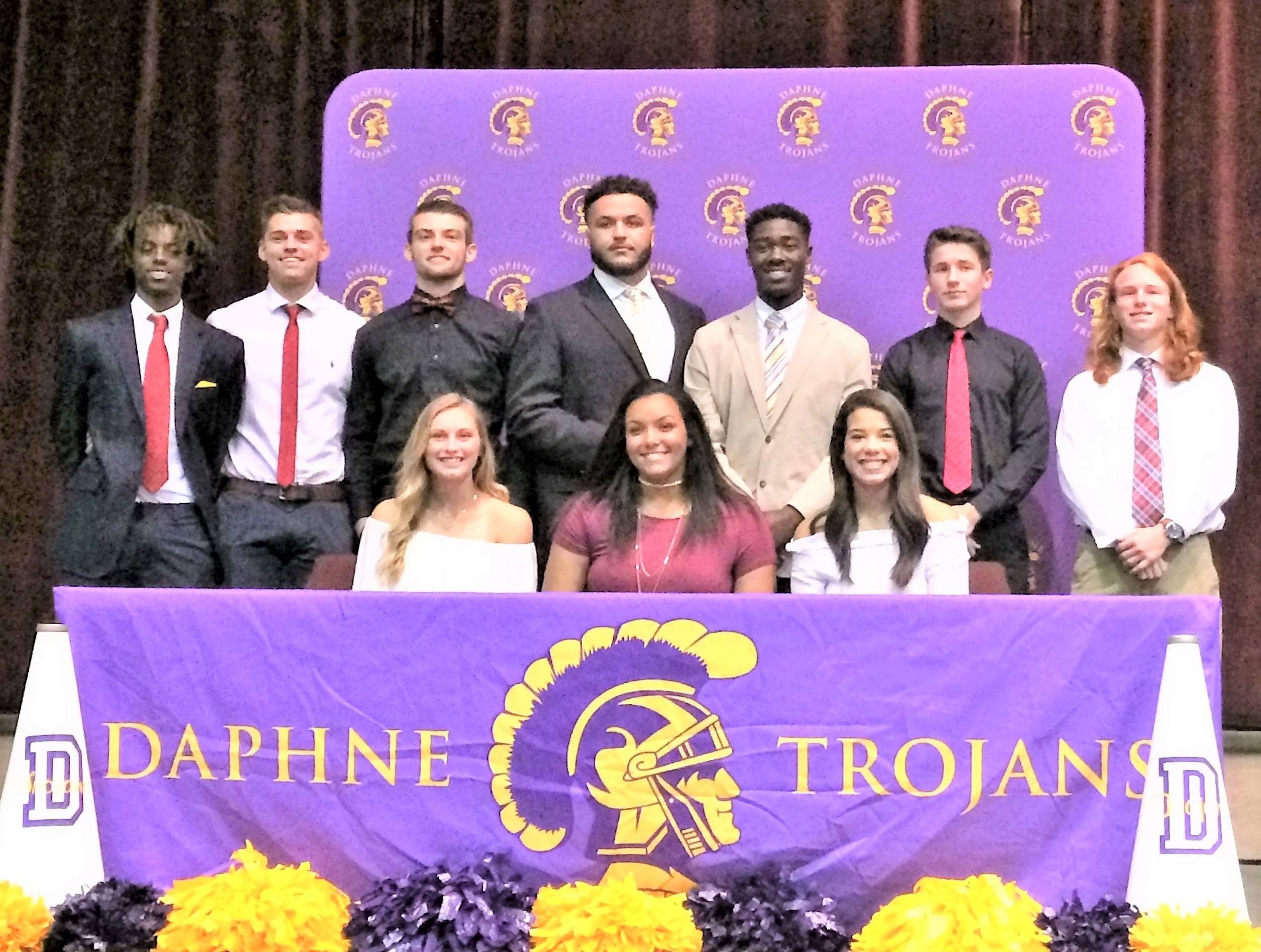 Daphne High signees, from left are standing, Kendrick Buskey, Chance Newman, Jacob Williams, Quincy Scott, Davon McMillan, Drake Wright and Wesley Perrigrin; seated are, Sydney Omtvedt, Bri Turner and Caylen Kidd.