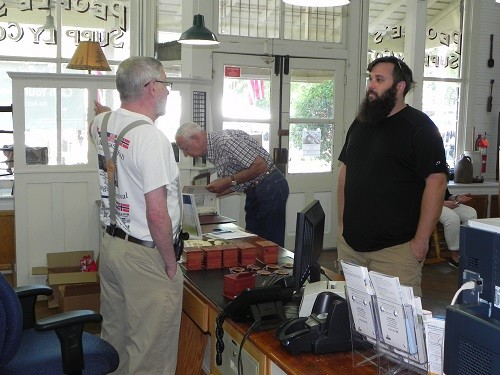 Peco Forsman speaks to a Heritage Day attendee at United Bank (historic People's Supply). He also gave a presentation at the Silverhill Covenant Church.