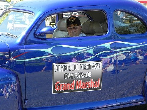 Parade Grand Marshal Frankie Kucera rolls down the street at Heritage Day in Silverhill.