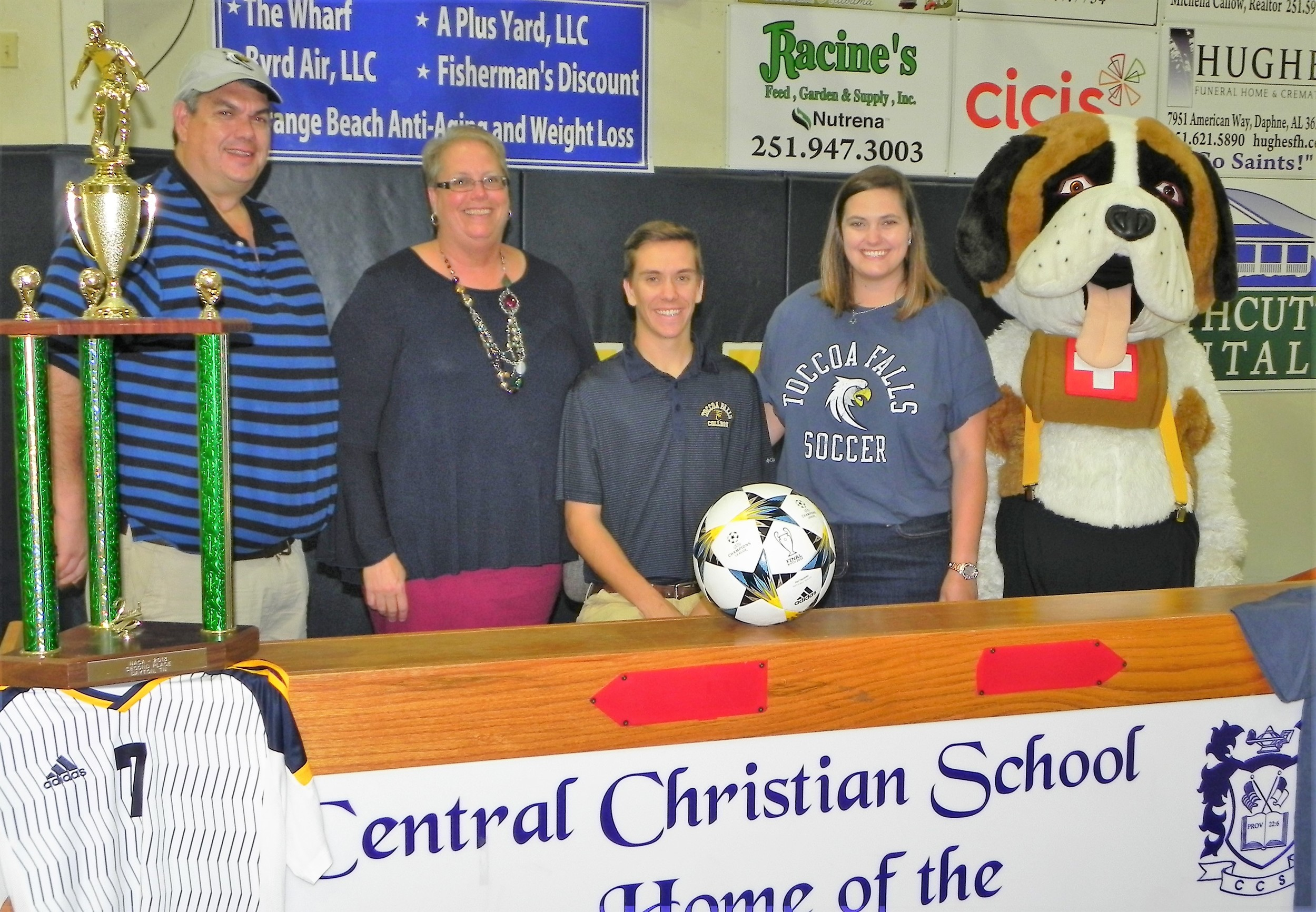 Daniel Crotts III signs Thursday with Toccoa Falls College in Georgia. Also pictured are parents Daniel and Renee Crotts and sister Justine along with the Saints mascot Barney.