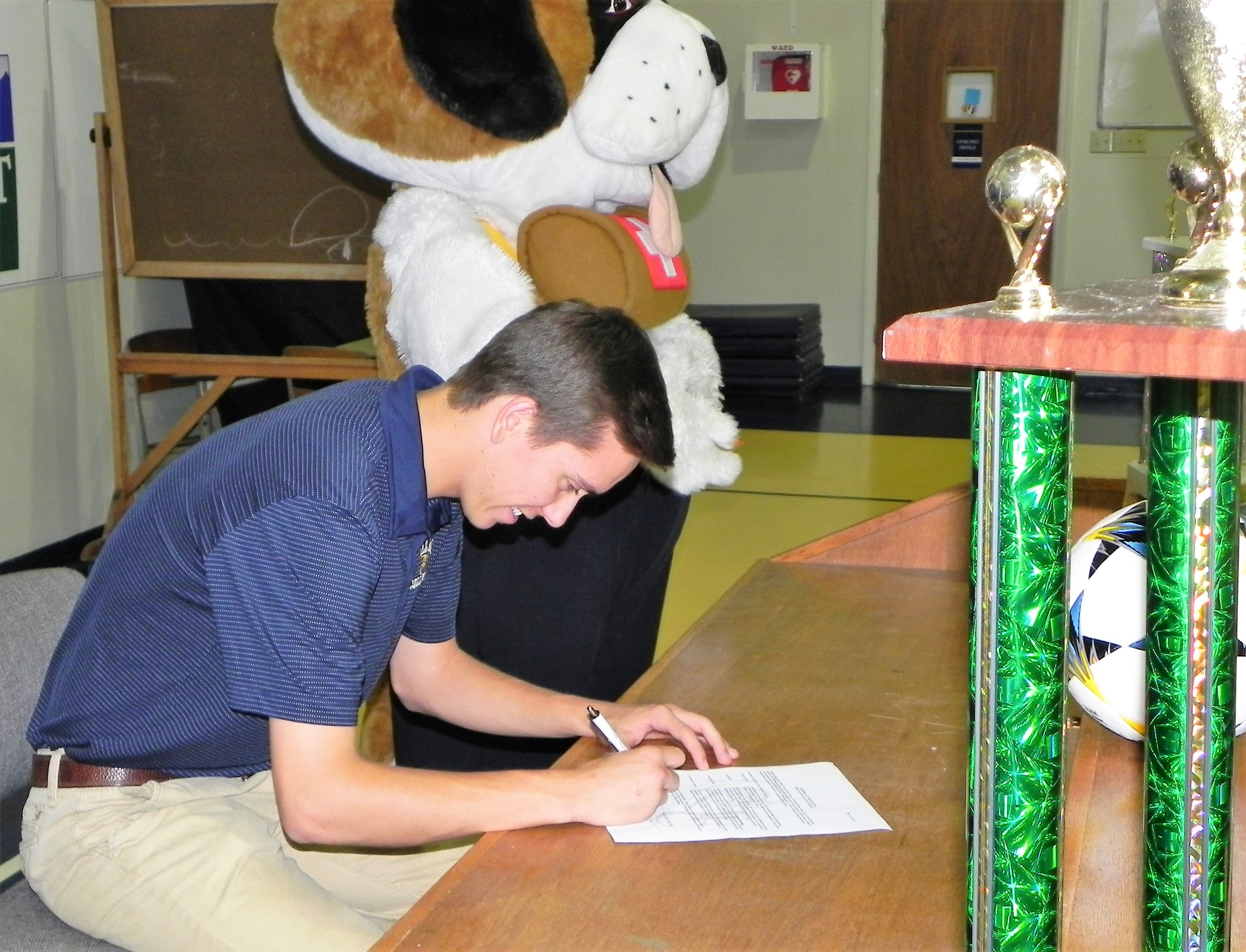 Central Christian senior Daniel Crotts, III signs to play soccer at Toccoa Falls College, Georgia with Barney, the CCS Saints mascot.