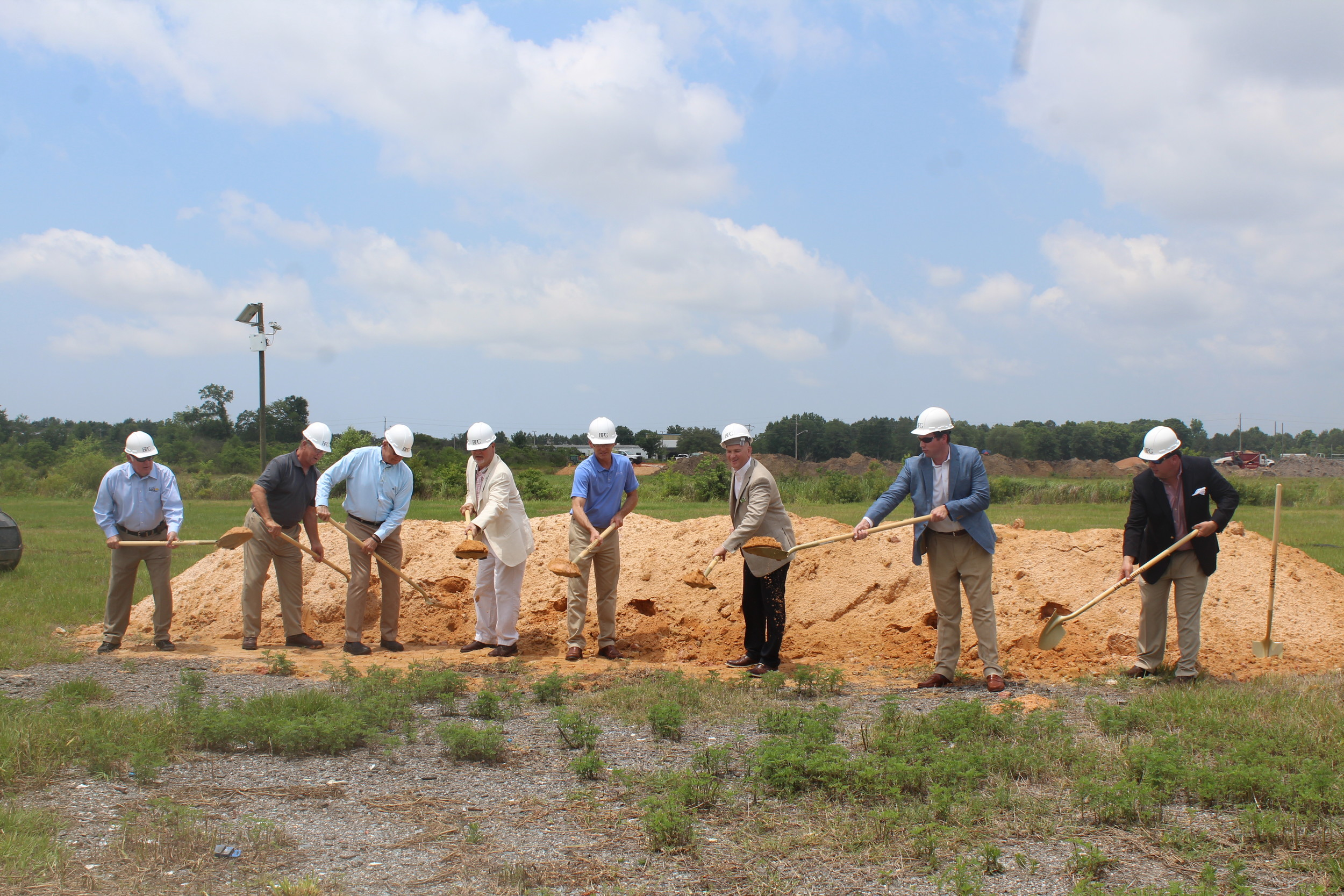 Burton Property Group employees and Foley city officials break ground for the new Foley/Riviera Square.