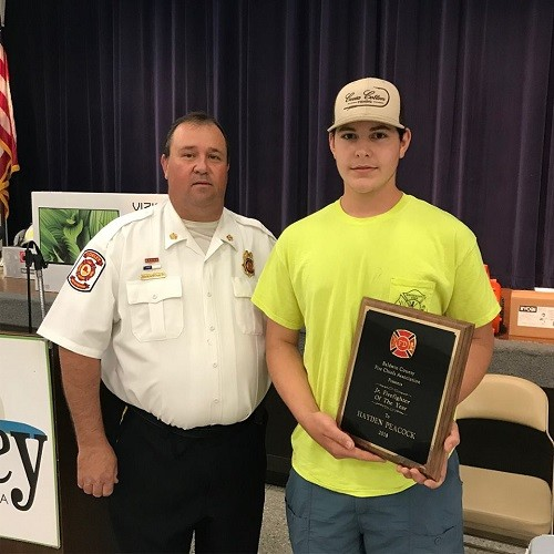 Hayden Peacock received the Junior Firefighter of the Year award from Alabama Fire Chiefs Association President Tony Lovell.