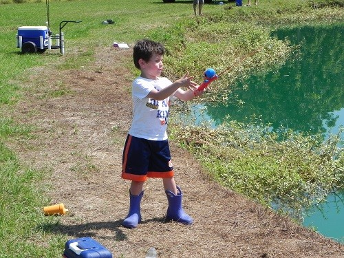 C.J. Hitchcock, 4, of Elberta casts his line hoping for a big catch.