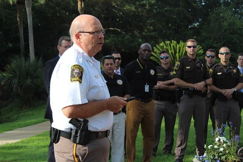 "Baldwin County Sheriff Huey ""Hoss"" Mack Jr. addresses officers during a canine officer memorial service held Friday, May 25 at the Baldwin County Sheriff's Department memorial located at the central investigations command office in Robertsdale."