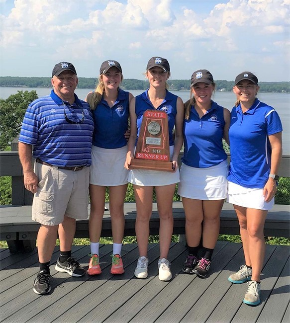 Pictured from left: Bayside Golf Head Coach Mark Lasseter; team members Tori Roush (sophomore), Paige Hammele '18 and Kaitlyn Morris '18; Golf Coach Caroline Beebe Skadow – BA Class of 2012.