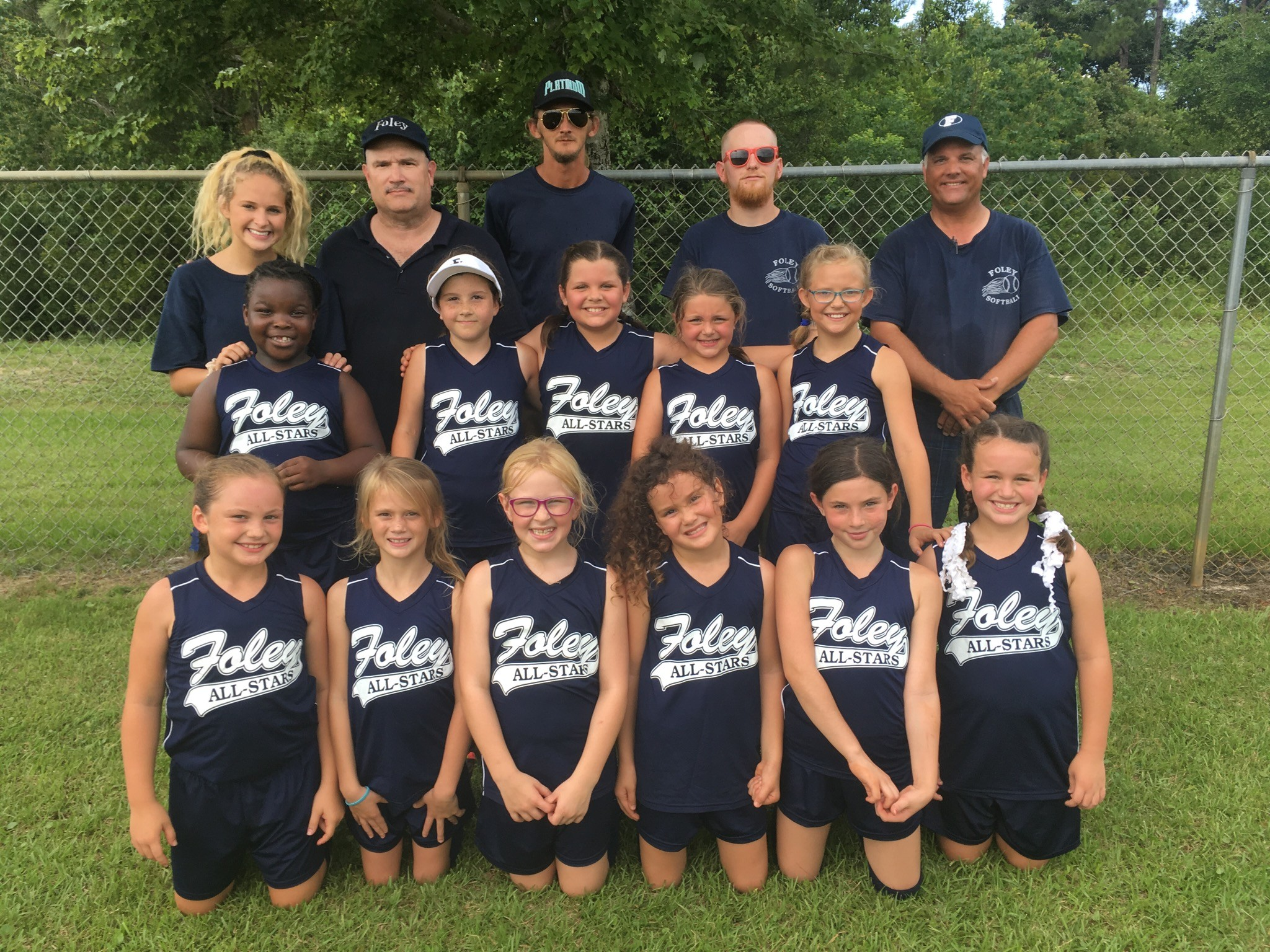 8U Age Group - Head Coach: Paul Shoenight. Assistants: Hunter Burnett, Nick Williamson, Matt Grundy, Victoria Burnett, and Amber Beavers. Players Standing Left to Right: Ashanti Williams, Makayla Shoenight, Kindle Potter, Machaela Newell, Haydyn Trawick. Kneeling Left to Right: Lynleigh May, Kaitlyn Williamson, Emily Crosby, Kylie McGehe, McKenzie Beavers, Bailee Egbert Player on Team but not in Picture: Constance Hall.