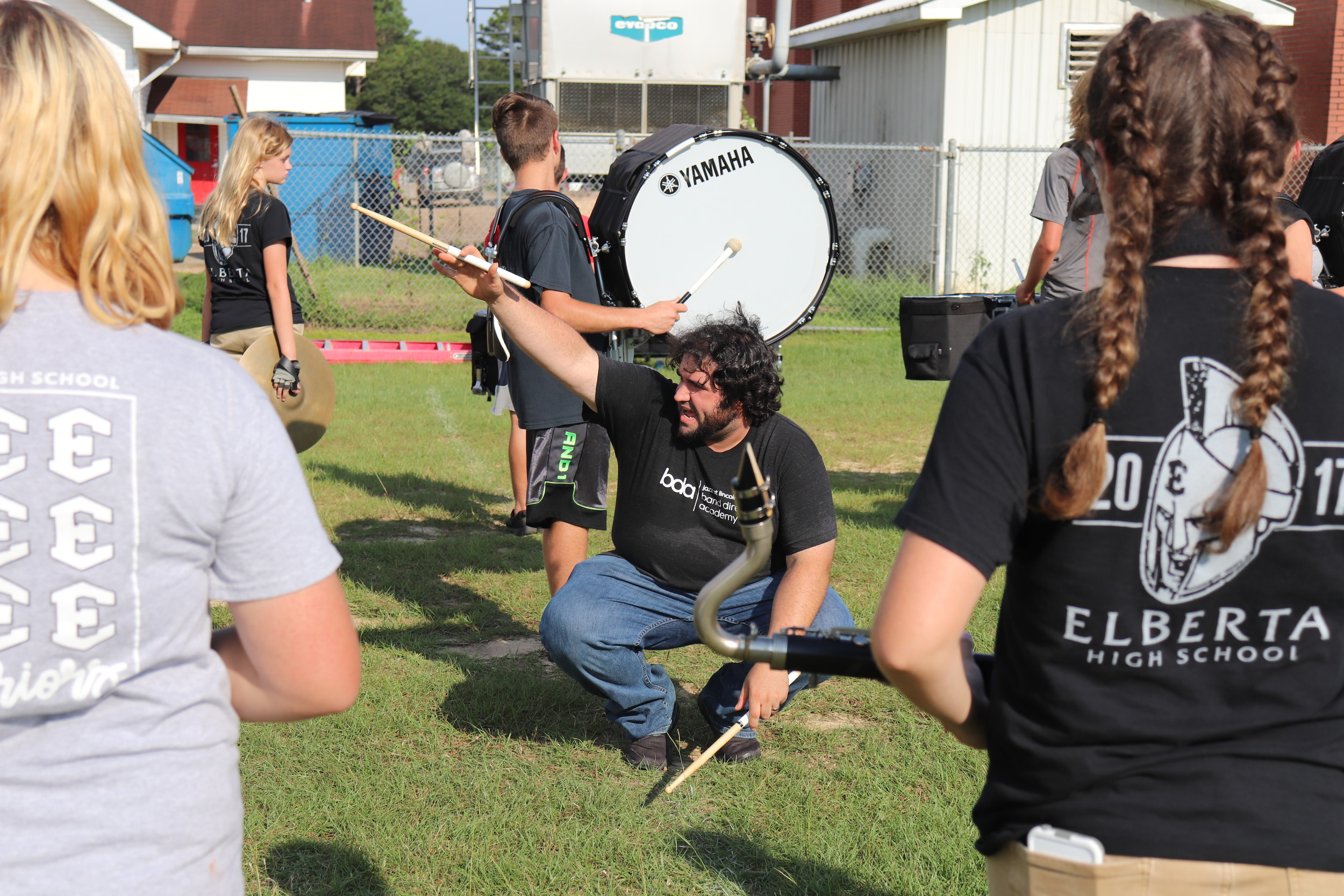 Elberta High School Band Director works with his students to help them learn marching movements during band camp.