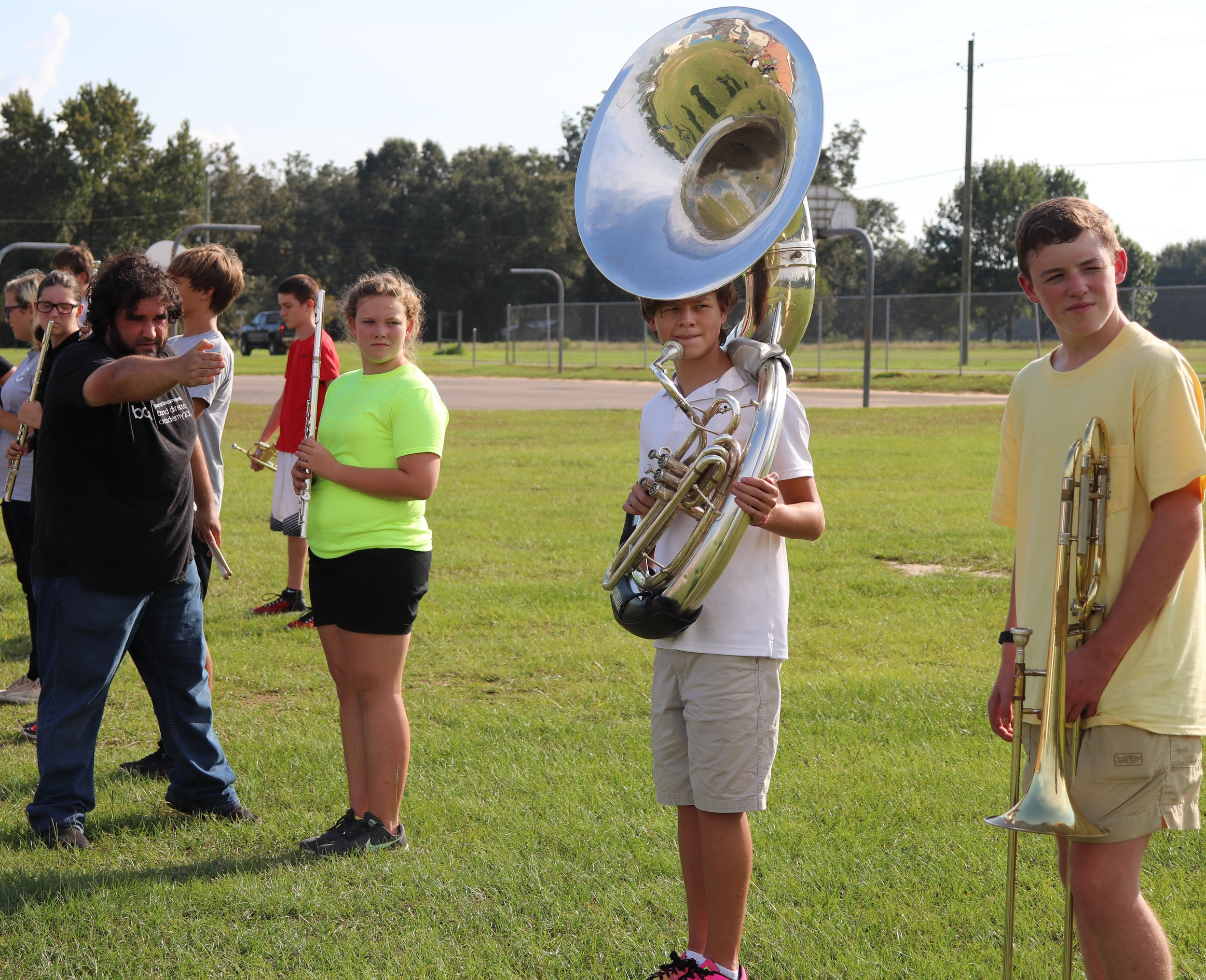 Elberta High School Band Director Josh Cockrell helps his students learn marching movements during band camp.