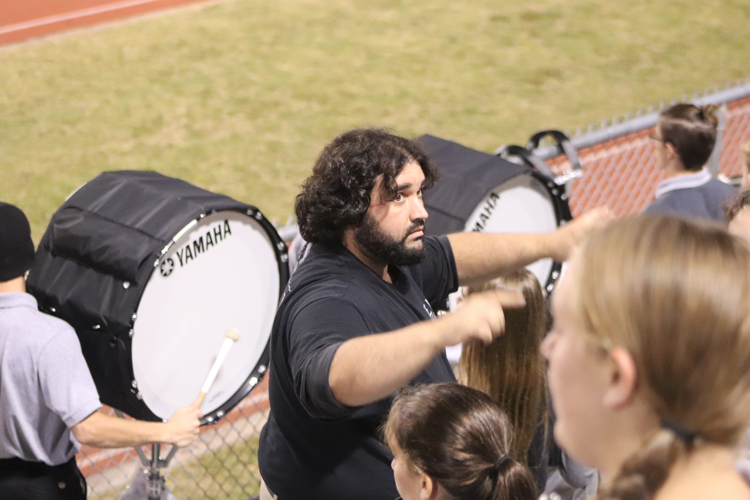 Elberta High School Band Director Josh Cockrell directs his students in the stands during a football game.
