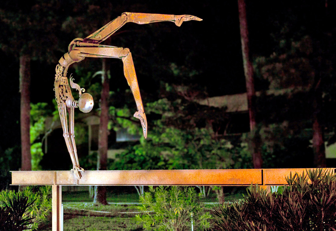 """Nastia the Gymnast"" is one of nine Bruce Larsen sculptures featured on the grounds of the American Sport Art Museum & Archives at the United States Sports Academy. The sculpture represents former United States Olympic gold medal gymnast Nastia Liukin."