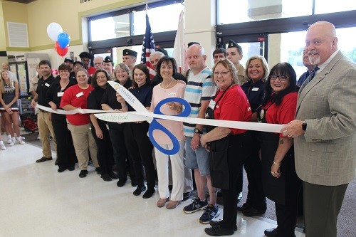Greer's family members and employees join officials with the city of Robertsdale and Central Baldwin Chamber of Commerce to cut the ribbon Wednesday, June 27 during grand opening ceremonies at the new Greer's CashSaver Robertsdale Market.