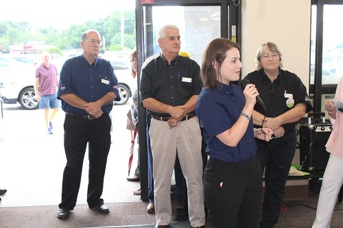 Corporate Spokesperson Lucy Greer Cheriogotis welcomes guests to the new Greer's CashSaver Robertsdale Market.