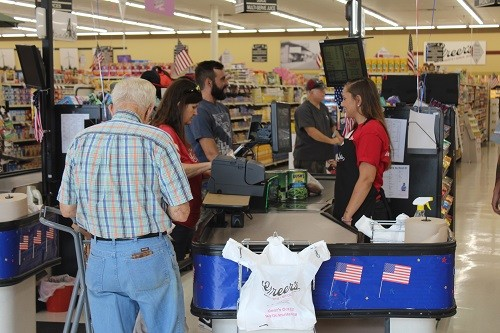 Shoppers flock to Greer's CashSaver Robertsdale Market for the store's grand opening on Wednesday, June 27.