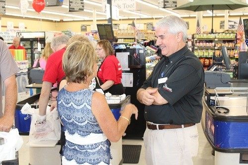 Greer's President Jackie Greer talks with guests at the grand opening of the new store in Robertsdale June 27.