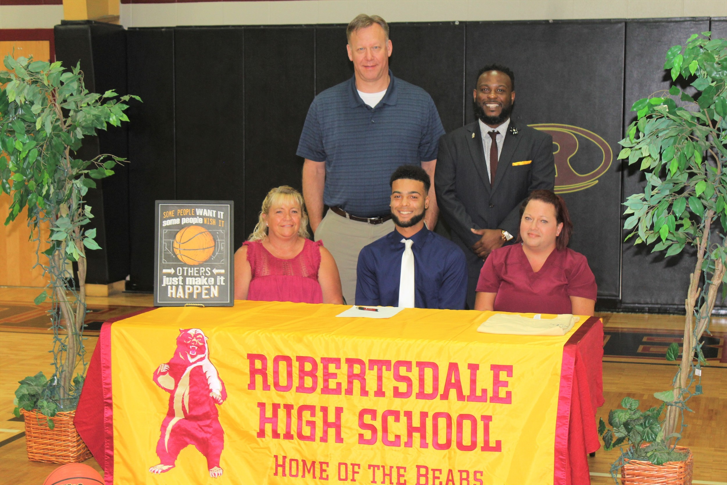 Caden Willingham of Robertsdale High School signs Monday, July 2 with Stillman College of Tuscaloosa as mother Jessica Gore and grandmother Patsy Willingham look on. Also pictured are RHS men's basketball coach Marshall Davis and RHS Principal Joe Sharp.