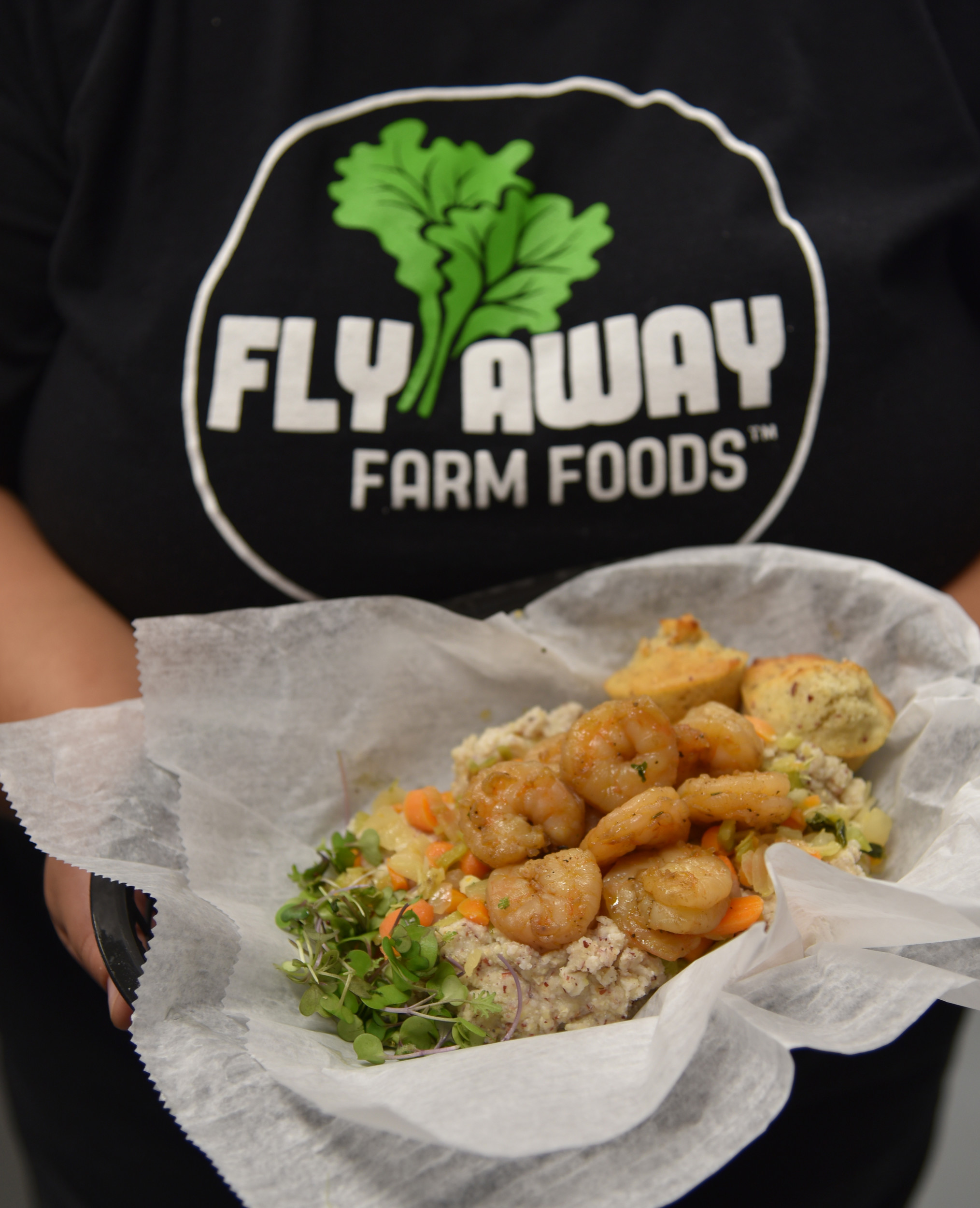 Shrimp and grits at Fly Away Farm Foods is made with shrimp from Bon Secour, Heirloom Grits from Bayou Cora Farms in Bon Secour and microgreens from Ship Shape Urban Farm in Mobile.