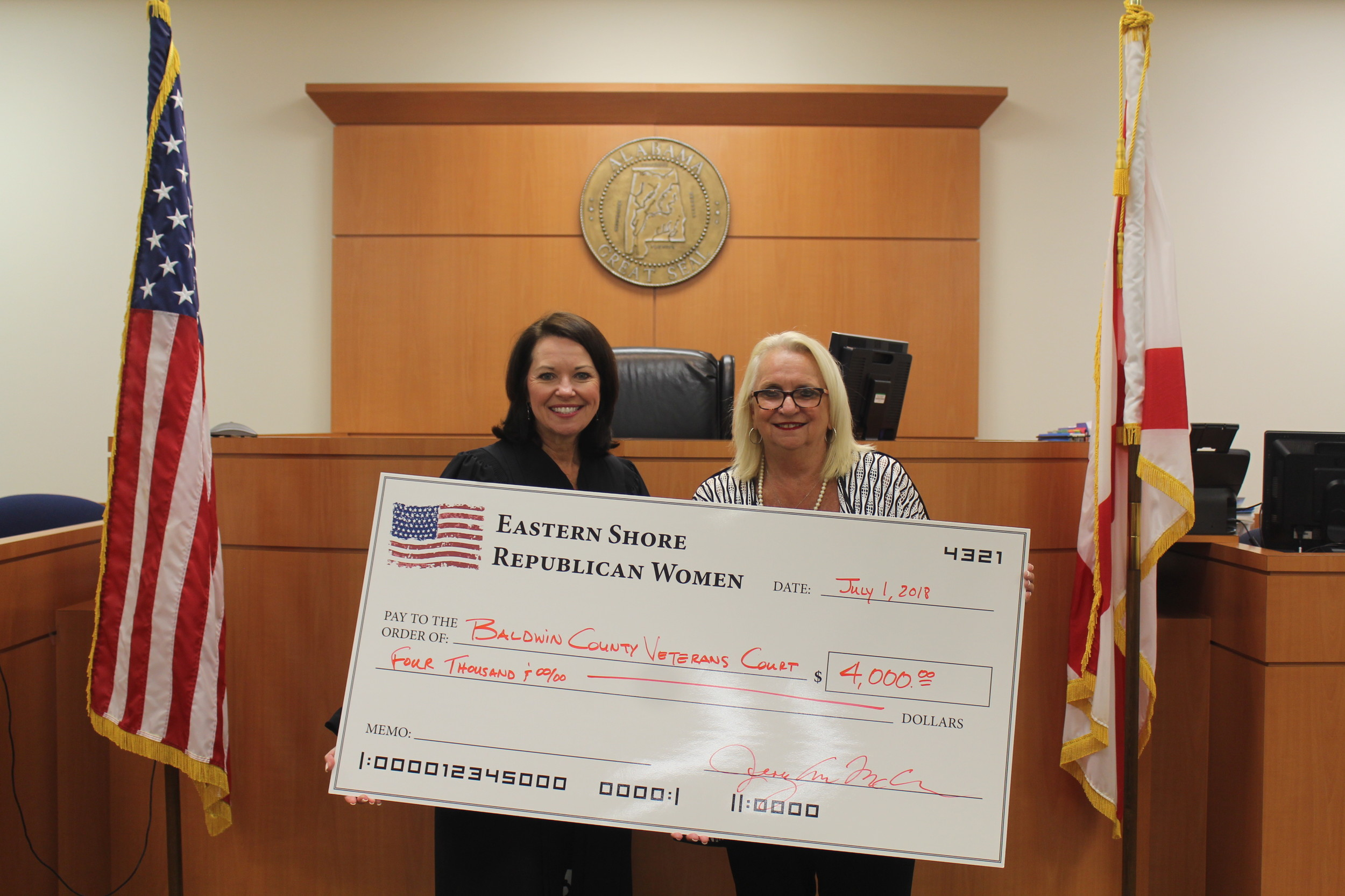 Eastern Shore Republican Women President Jerry Ann McCarron presents a $4,000 check to Judge Michelle Thomason for the Baldwin County Veterans Court.