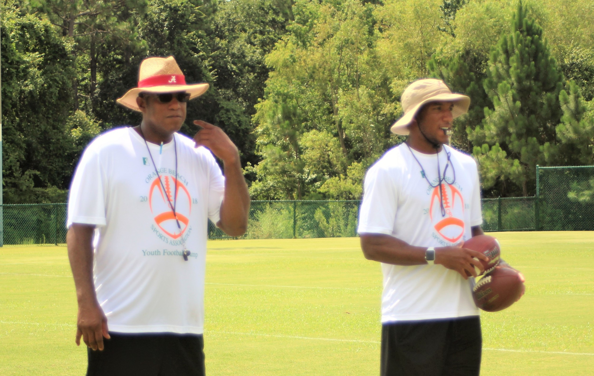 Bobby Humphrey, left and son Marlon Humphrey give instructions to campers at Orange Beach.