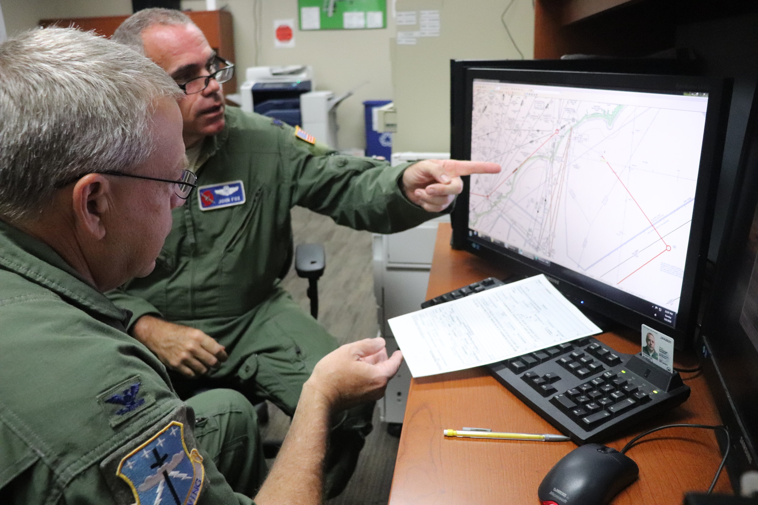 Members of the 53rd Weather Reconnaissance Squadron plot their course before flying into Hurricane Chris.