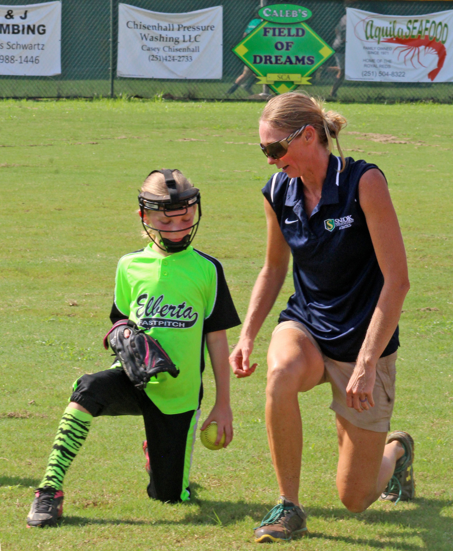 Lady Eagles head softball coach Stephanie Garris with a camper at Snook Christian.