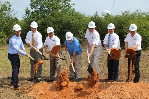 Loxley Mayor Billy Middleton and County Commissioner Chris Elliott, along with officials from the Kaishan Group and Bayshore Construction Co. Inc. break ground Monday at Kaishan's new 65,000-square foot U.S. corporate headquarters and manufacturing facility in Loxley.