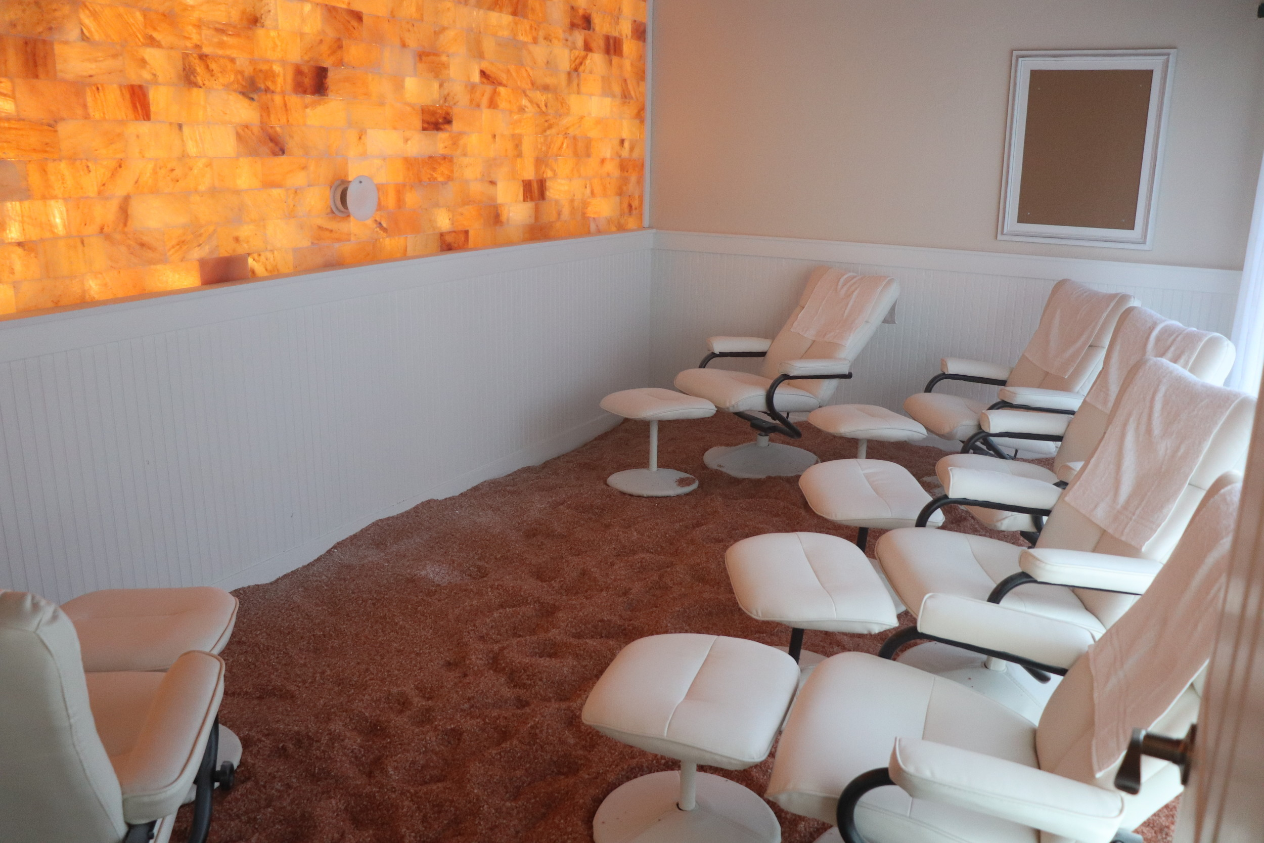 Guests relax as micro-particles of pharmaceutical grade pink Himalayan salt floats through the room.