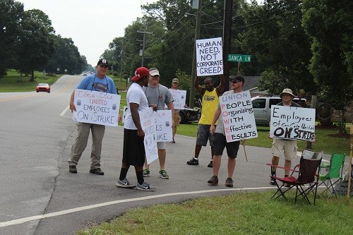 Coca-Cola employees strike in front of the distributing plant in Robertsdale last week.