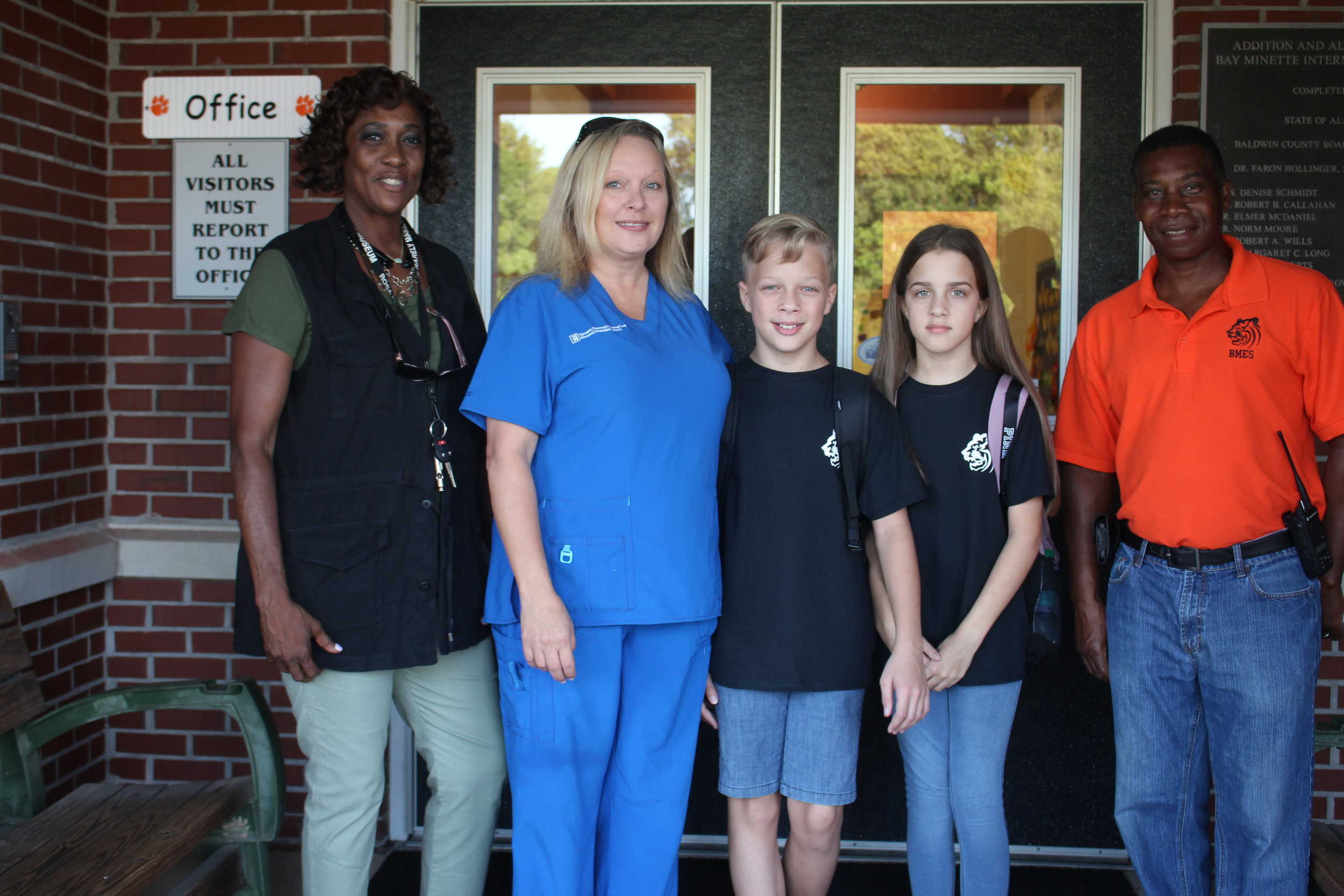 Sixth grade teacher Merlyn Kittrell and maintenance staff member Albert Bishop were on hand to greet parents and students on the first day of school. Melissa Roberts brings twins Landon and Kara to school to begin sixth grade.