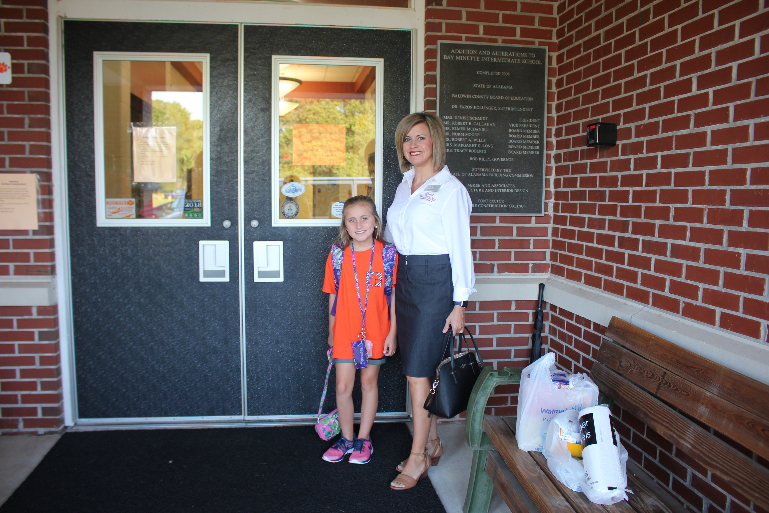 Tiffany Scarborough escorts her sixth grader Addison with bags of supplies on the first day of school.