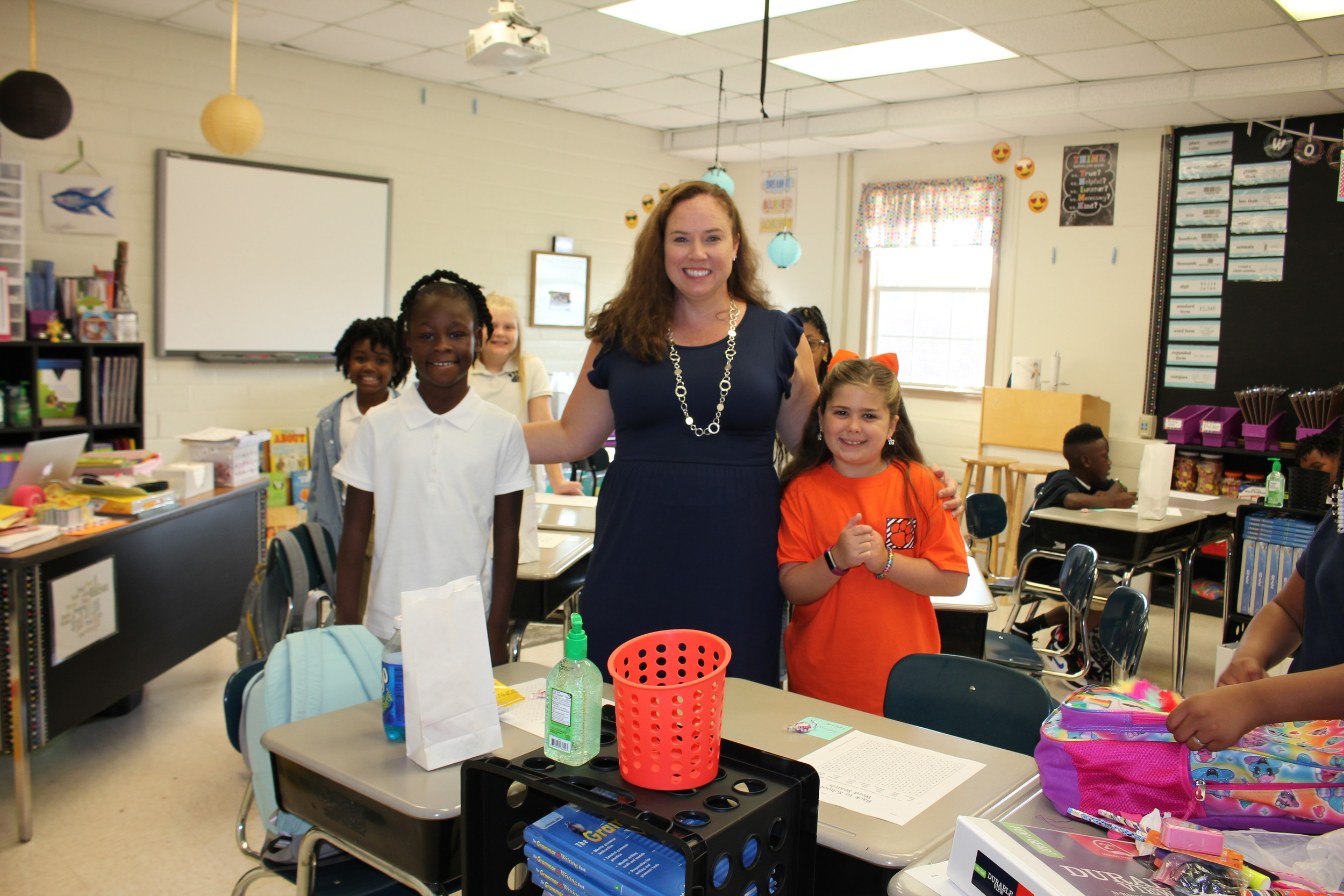 Fourth grade teacher Sharon Bell helps her new class get unpacked and ready to learn.