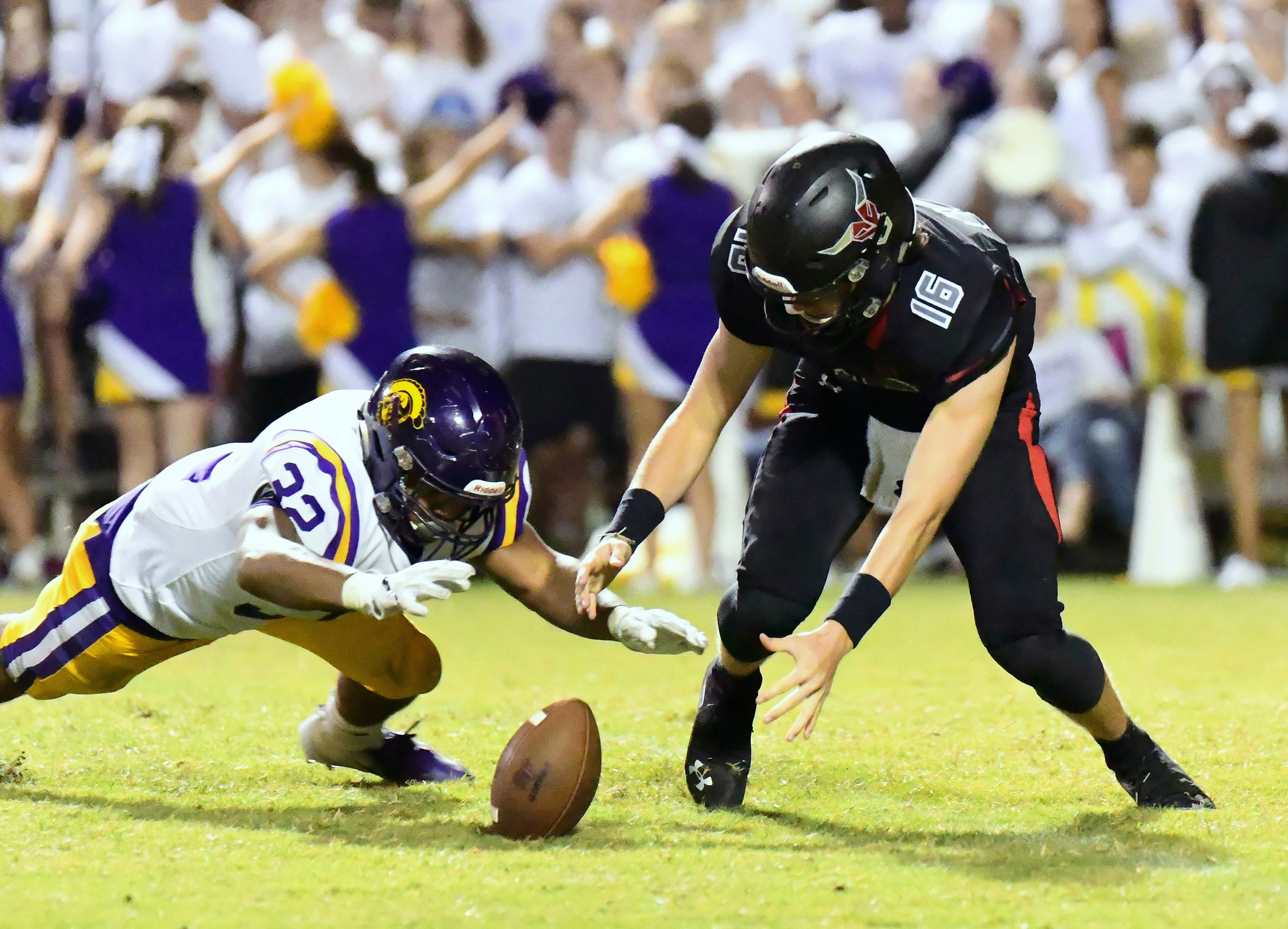 Jon Davis dives to recover a loose ball for DHS as SF QB Jackson Burkhalter reacts.